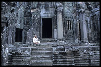 A Buddhist nun is resting inside the Bayon. Siem Riep, Angkor, Cambodia