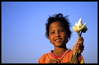 A Cambodian girl sells flowers at the riverfront in Phnom Penh.