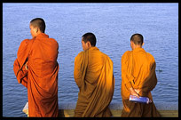 Three monks are enjoying the view of the Mekong at Phnom Penh's riverfront.