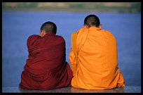 Buddhist monks are enjoying the view of the Mekong at Phnom Penh's riverfront.