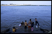 Cambodian children enjoying a fresh dive into the Mekong at Phnom Penh's riverfront.