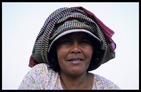 Portrait of a Cambodian woman at Phnom Penh's riverfront.