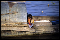 A Cambodian girl is looking from a boat in the Mekong river.
