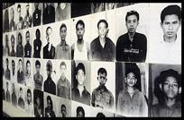 Photographs of prisoners covering the walls from floor to ceiling in Tuol Sleng (S-21).