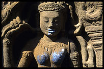 The blue breasts and lips of a Theravada statue at Wat Nokor, near Kompong Cham.