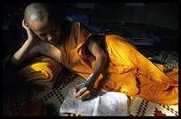 A monk is making his homework inside Wat Nokor, near Kompong Cham.