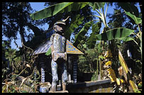 Tompuon cemetery with wooden statues resembling the deceased in the forest. Kachon, Ratanakiri, Cambodia