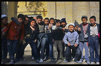 Children at the cemetery behind the Altyn Mosque. Yarkand, Xinjiang, China