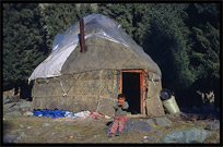 Kazak boy next to his yurt at Heaven Pool or Heavenly Lake (Tian Chi). Urumqi, Xinjiang, China