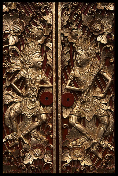 Amazing wood carved doors in the streets of Ubud displaying religious figures.