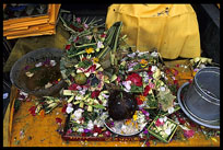 A table full of worship flowers and fruits.