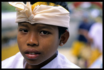 A Balinese boy traditionally dressed up in Amlapura.