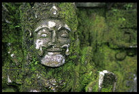 Balinese statues covered with moss in Bangli.