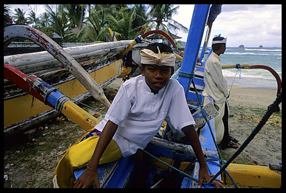 A typical Balinese fisherboat guarded by locals.