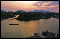 Sunset, overlooking the Cambodian mountains, on the four thousand islands. Si Phan Don, Don Khon, Laos