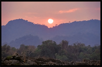 Sunset, overlooking the Cambodian mountains, on the four thousand islands. Si Phan Don, Don Det, Laos