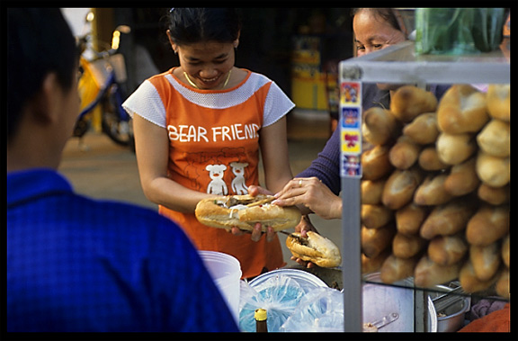 Selling French baguettes. Pakse, Laos