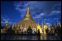 Silhouettes in front of the great golden dome of Shwedagon Paya in Yangon.