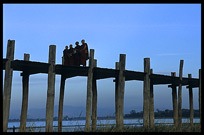 Monks crossing the U Bein Bridge at Amarapura.