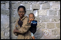 A Burmese woman and her child in Hsipaw.