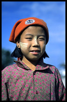 A Burmese girl wearing a western style hat in Hsipaw.