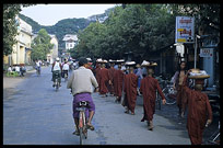 Monks in Pyay are walking down the street asking for gifts and food.