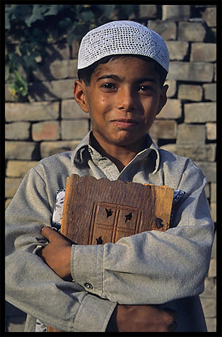 A young boy at the local mosque. Taxila, Pakistan