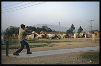 Playing cricket in an Afghan refugee camp. Taxila, Pakistan