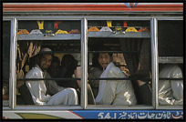 Colourful Pakistanis in colourful bus. Peshawar, Pakistan