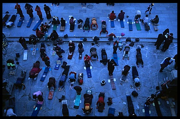 Pilgrims prostrating in front of the Jokhang early in the morning.