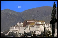 The moon sets over the Potala Palace from the roof of the Jokhang. Lhasa, Tibet, China