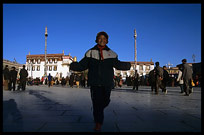 A Chinese girl playing on the Jokhang square. Lhasa, Tibet, China