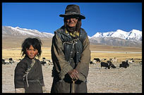 An old Tibetan pilgrim and her daughter on the road from Lhasa to lake Nam Tso. Nam Tso, Tibet, China