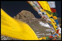 Tibetan prayer flags on the last mountain pass before Nam Tso. Nam Tso, Tibet, China