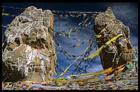 The twin rock towers with Tibetan prayer flags and mani stones at Nam Tso. Nam Tso, Tibet, China