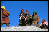 A colourful family of Tibetan pilgrims walking the Nam Tso Kora. Nam Tso, Tibet, China