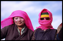 Two very colourful Tibetan pilgrims at lake Nam Tso. Nam Tso, Tibet, China