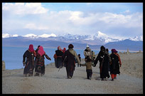 A family of Tibetan pilgrims walking the Nam Tso Kora. Nam Tso, Tibet, China