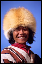 A smiling Tibetan pilgrim walking the Kora at lake Nam Tso. Nam Tso, Tibet, China