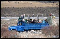Pilgrims in a truck on their way to Reting monastery. Tibet, China